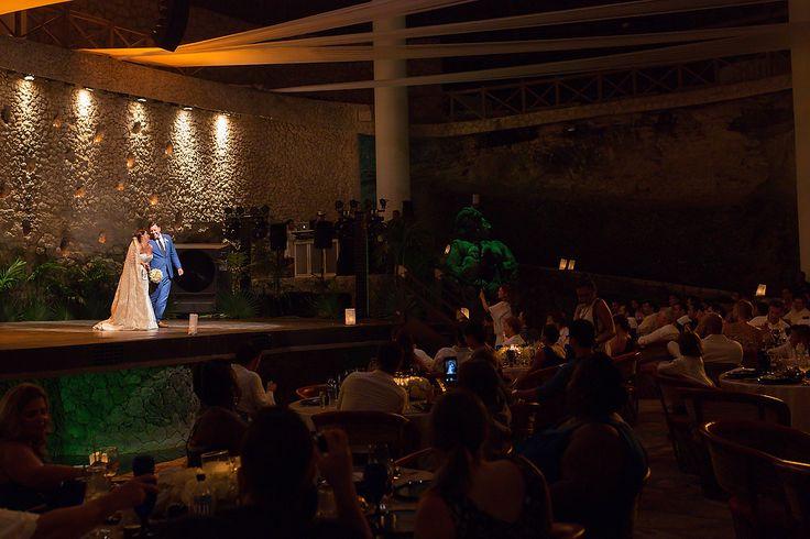 Big applause for the newlyweds. Wedding reception at La Isla Restaurant, Xcaret, Mexico. Quetzal Wedding Photo