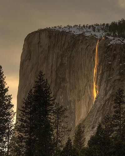Yosemite; for only 2 weeks per year in February, the lighting is just right for the setting sun to reflect off the granite behind the waterfall, turning the water into fire.  It might only happen for 10 minutes on one day; it all depends on the weather.  So cool.
