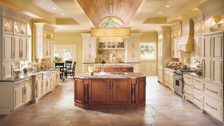 Vintage Biscotti on Cherry surrounds islands in Burnished Praline on Maple to emphasize space while retaining a country feel.