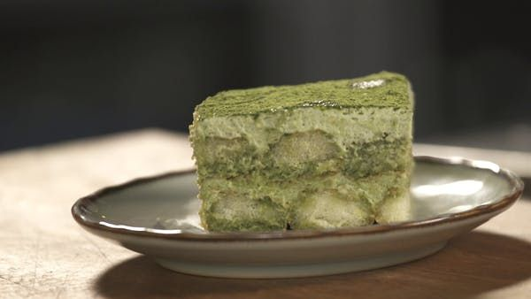 Recipe with video instructions: Instead of adding coffee and finishing your tiramisu with a dusting of cocoa powder, use matcha for a yummy, earthy twist. Ingredients: 6 egg yolks, 3/4 cup white sugar, 1/2 cup milk, 16 oz  or 2 ½ cups mascarpone cheese, 1 1/4 cups cold heavy cream, 1/2 teaspoon vanilla extract, 1 tbsp matcha powder, An additional ½ cup of matcha powder for dusting., 2 packets of lady fingers (ones from Trader Joe's is good), 1 cup boiling water, 1/2 c...