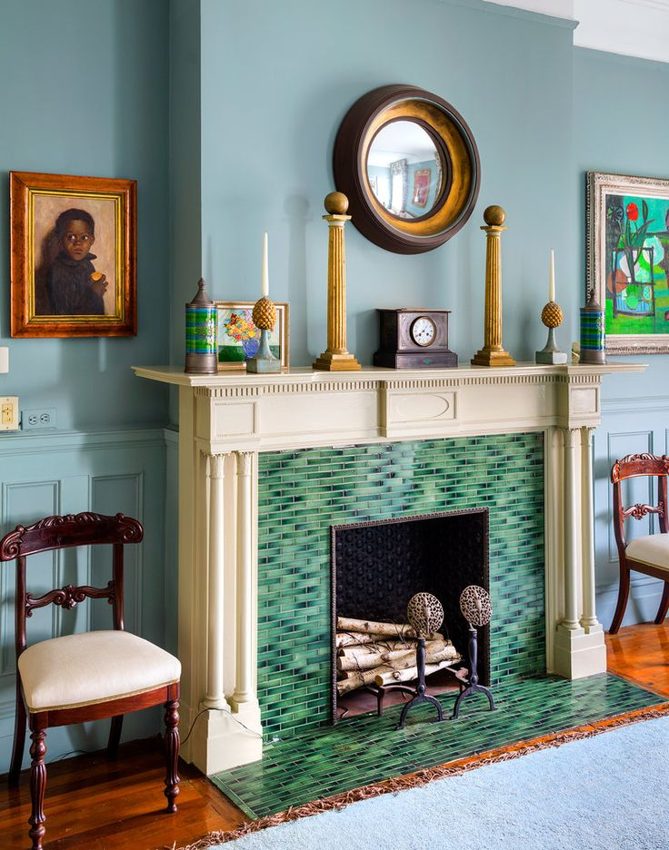 Green tiled fireplace in Sheila Bridges' Harlem apartment