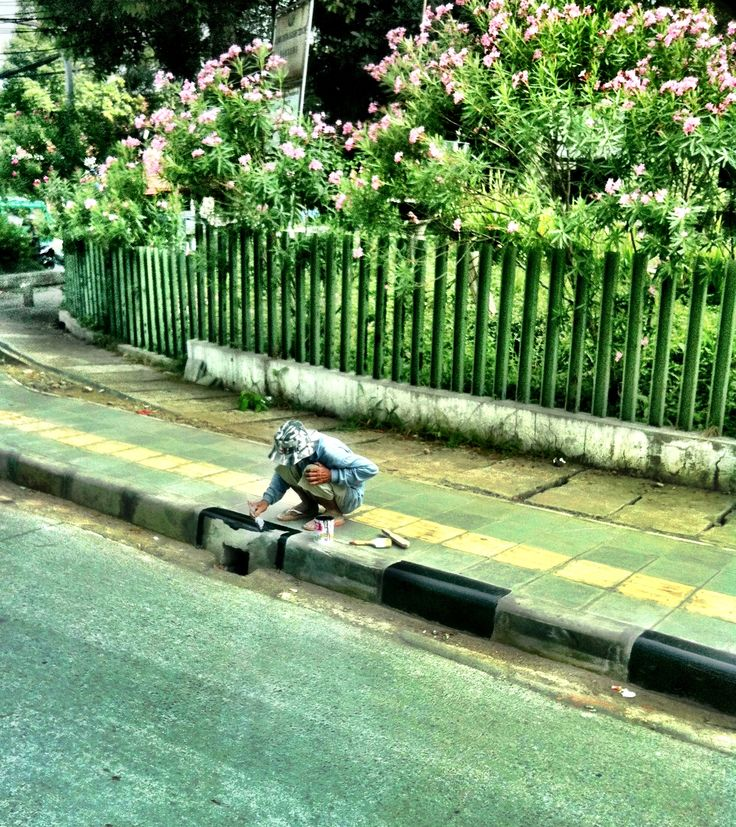 Curb painter at work in Bandung Indonesia