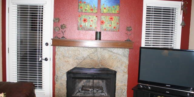 Cute as a button! This corner, ground floor unit condo offers no stairs, interior has been tastefully redone with new paint, trim and blinds. Backs to a greenbelt in Independence Park with walking trails nearby. Shopping is within walking distance.Dues cover exterior maintenance & repair, water/sewer, trash pickup, grounds maintenance. Schedule your viewing today! It will not disappoint you!