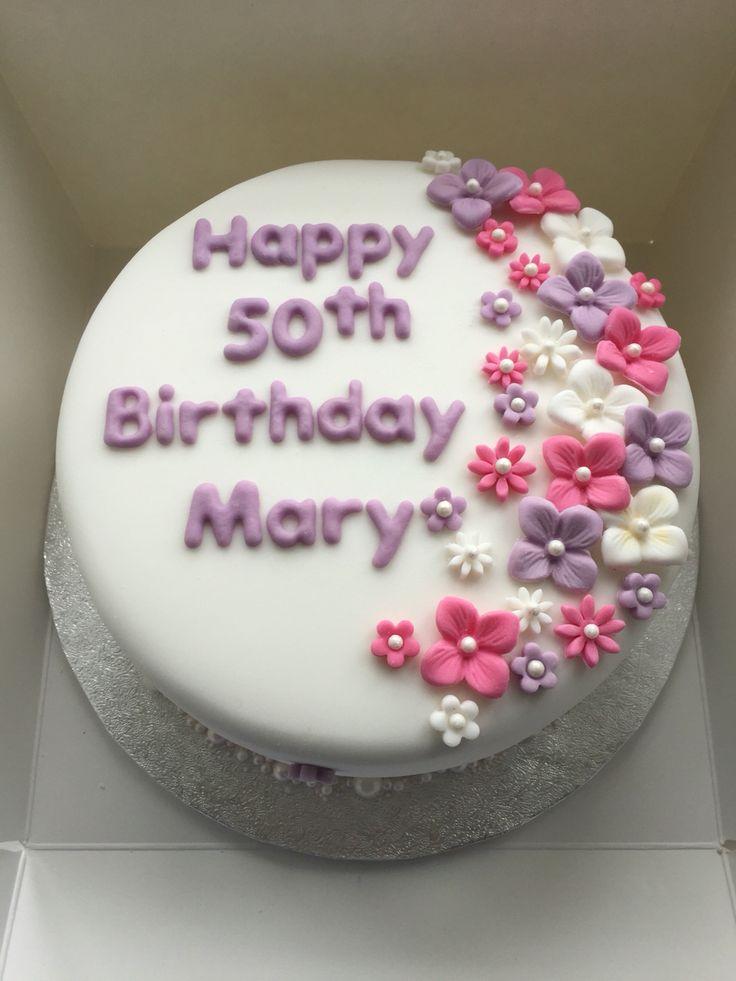 Floral 50th birthday cake. Vanilla sponge with strawberry jam and vanilla buttercream.