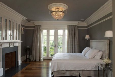 Dark Grey Wall Color Scheme and Classic Fireplace with White Bedding Sets in Traditional Bedroom Design Ideas