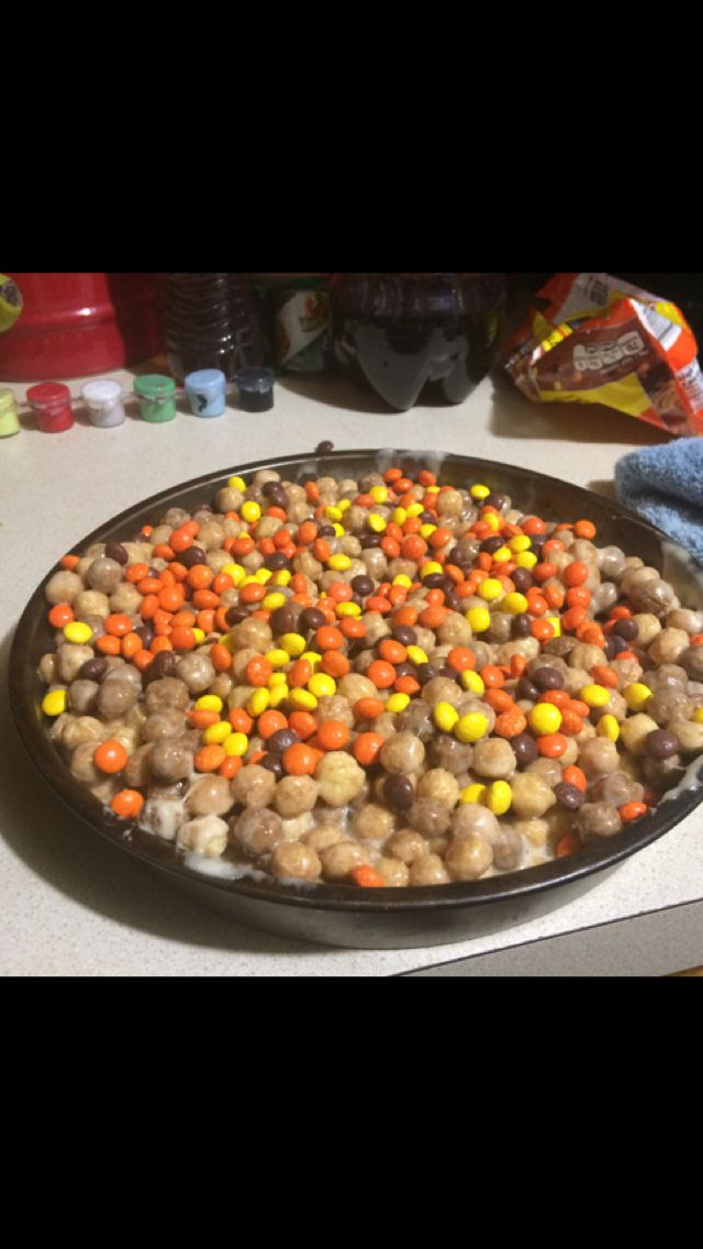 """Rice Krispies"" but made with Reese's puffs and Reese's pieces. The definition of high food."