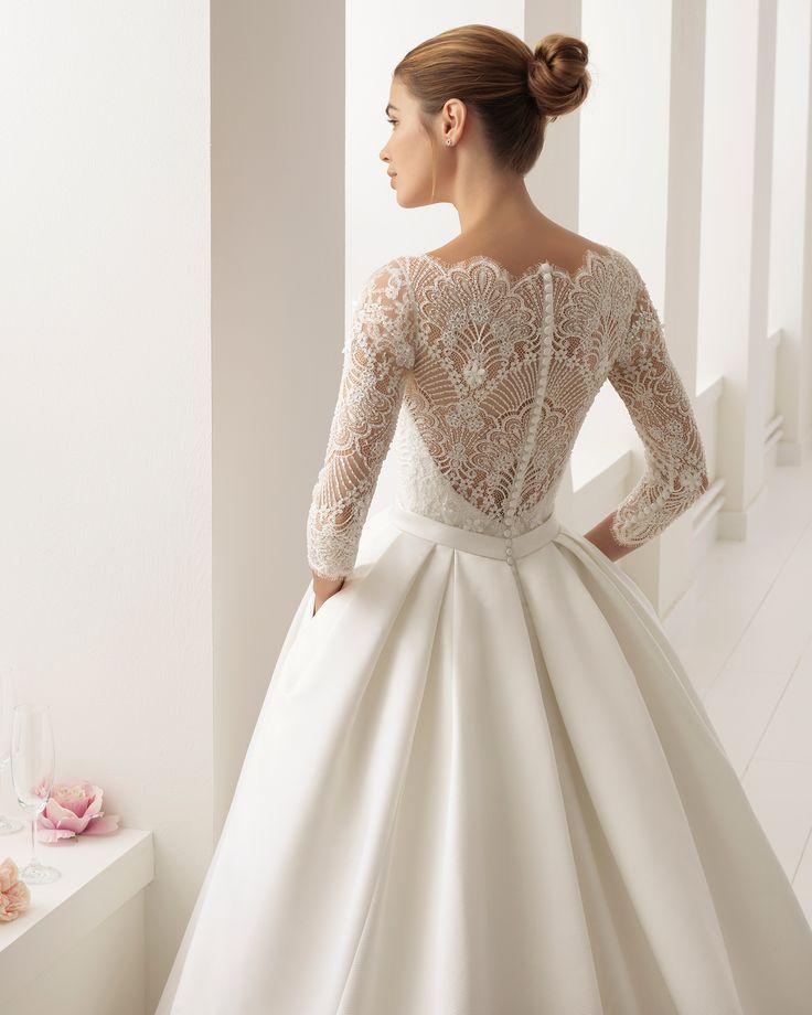 Vestido de novia estilo clásico en otoman, encaje y pedreria, con manga francesa con escote ilusión.