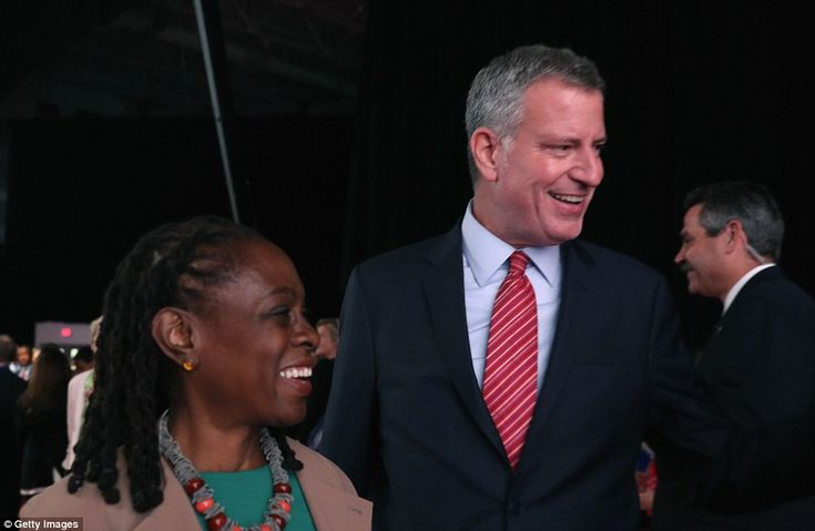 Clinton supporters New York City Mayro Bill de Blasio (right) and his wife Chirlane McCray (left) have arrived