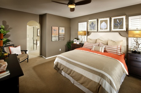 Deep Taupe Walls And Lighter Crisp Bedding With Orange