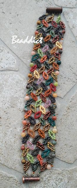 Diagonal leaf cuff. Pattern: Barbara L. Grainger. Beaded by Beaddict. Seed beads, semiprecious gemstones.