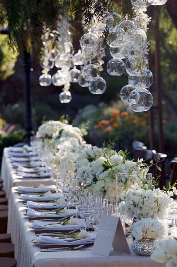 long table setup wedding reception%0A long tables with white linens and arrangements of peonies and sweet peas   and hanging glass bubbles