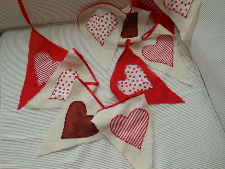 Red hearts appliqued onto the flags for Valentine bunting