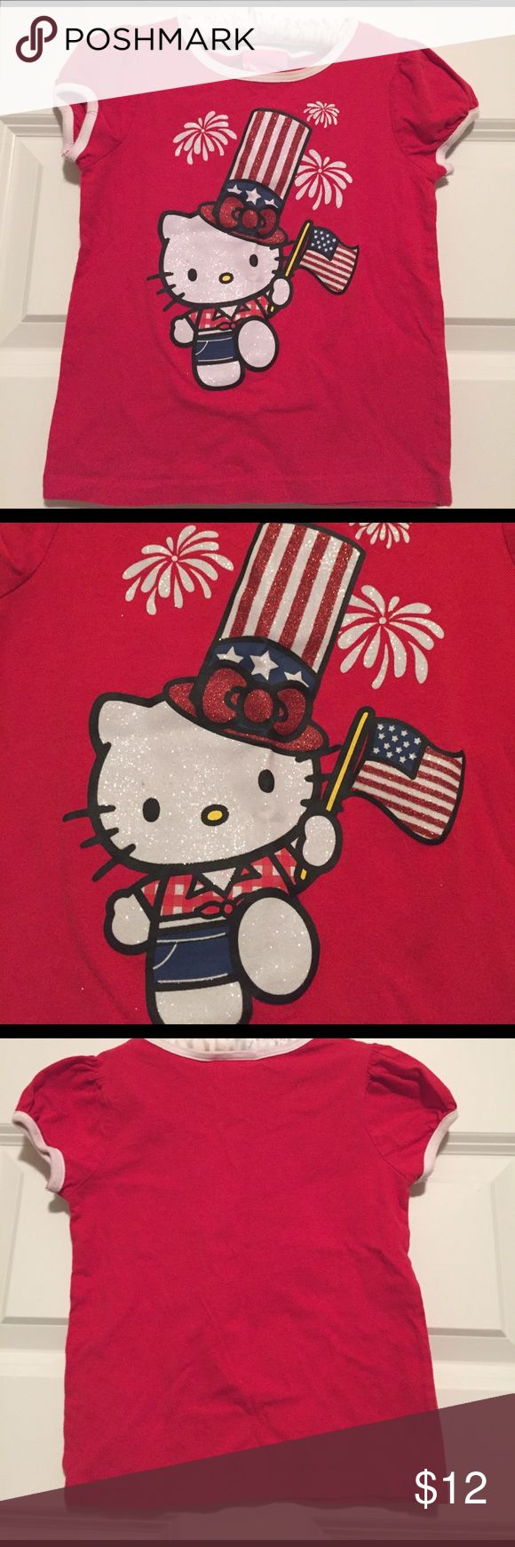 Hello Kitty July 4th Tee Hello Kitty July 4th tee with glitter appliqué. Name in sharpie on tag. Hello Kitty Shirts & Tops Tees - Short Sleeve