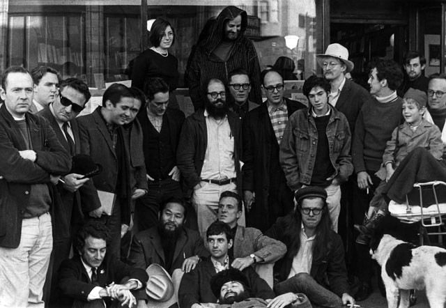 The Last Gathering of the Beats. City Lights Books, 1965. Front Row (L to R): LaVigne, Murao, Fagin, Meyezove (lying down), Welch, Orlovsky, Homer. Second Row: Meltzer, McClure, Ginsberg, Langton, Steve, Brautigan, Goodrow, Frost. Back Row: Levy, Ferlinghetti.