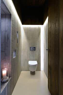 Baños de estilo  por Ricardo Moreno Arquitectos https://www.homify.com.mx/libros_de_ideas/3842834/6-ideas-para-colocar-azulejos-modernos-en-tu-bano