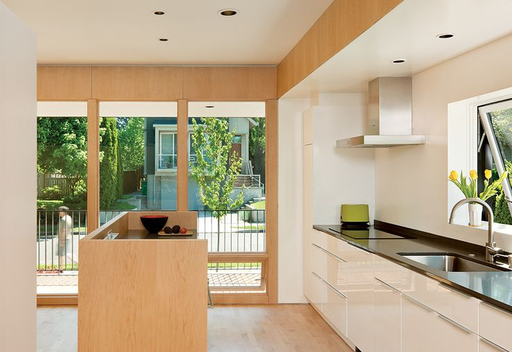 The kitchen is outfitted with Akurum cabinets from Ikea. The island is also an Ikea cabinet, customized with maple panels to match the flooring.