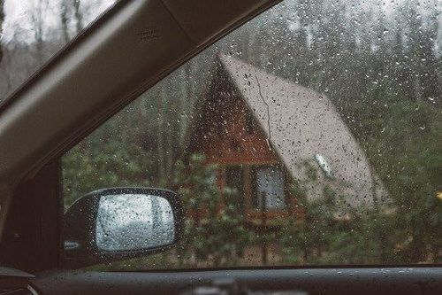 It's early dawn when Luka stirs next to me. Rain lightly drizzles on the windshield and when I look out the window I see us pulling up to a large log cabin.