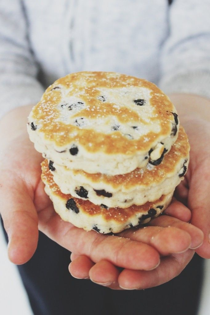 Welsh cakes. Similar to griddle scones, they have added fruit in the form of currants or raisins and are cooked on a griddle or in a frying pan.