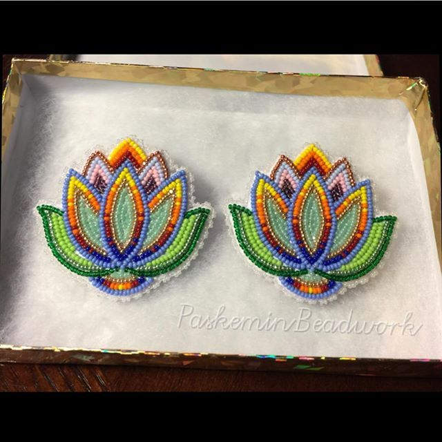 Earrings made with size 13 charlotte beads. #florals #beadwork #paskeminbeadwork