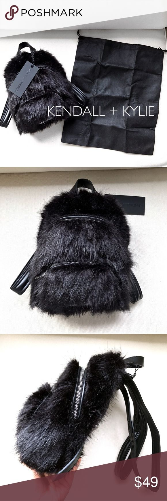 KENDALL + KYLIE Black Faux Fur Mini Backpack 🖤 Brand new, with tags. The faux fur is super fluffy and soft. 2 silver zipper pockets. The larger, main pocket has 2 small open pockets inside. Adjustable straps. Feedback that measures approximately 10 inches high, 4.5 inches deep and 8 inches wide. Business card pocket in the back of the backpack. Kendall & Kylie Bags Backpacks