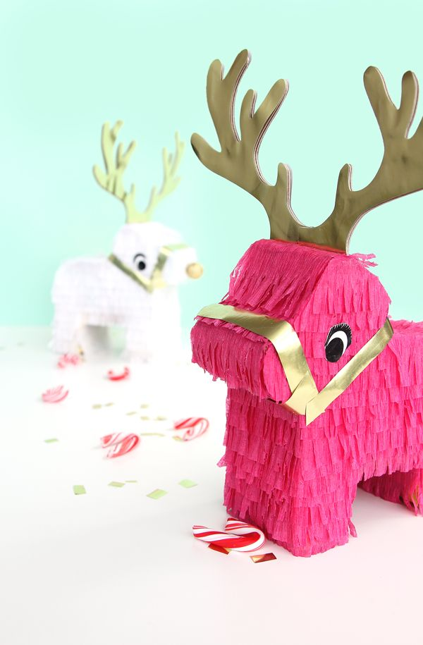 Even though we started the holidays a bit early this year with Christmas tree cupcakes, gummy bear cookies, and my current wrapping obsession – now it is definitely holiday season. I'm jumping right in with these fun reindeer pinatas. A similar concept to the unicorn pinatas, except reindeers! Because reindeers are the magical creatures I am …