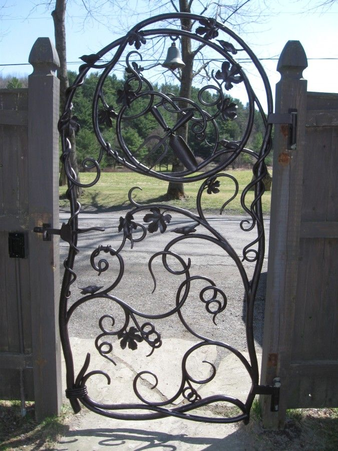 Not only is the gate stunning but the owners had a bell incorporated into the design...no sneaking into this garden!