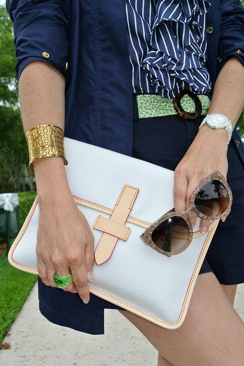 June 10, 2013 http://www.akeytothearmoire.com/post/52624027125/back-in-casual-business #navy #blue #green #shorts #ruffled blouse #stripes #white #Prada lace sunglasses #Ralph Lauren #Polo #ballerina flats #Vera Bradley #El Corte Ingles #Brotes #raincoat #windbreaker #pierced cuff bracelet #Dooney & Bourke #Murano glass