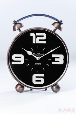 Επιτραπέζιο Ρολόι 50ties Copper Επιτραπέζιο ρολόι σε ένα διαχρονικό design που παραπέμπει στη δεκαετία των 50ties, στο χρώμα του χαλκού. Υλικό :σίδερο, αλουμίνιο και γυαλί. Λειτουργεί με μπαταρία 1x LR6 - AA (εκτός), και δεν διαθέτει ξυπνητήρι.