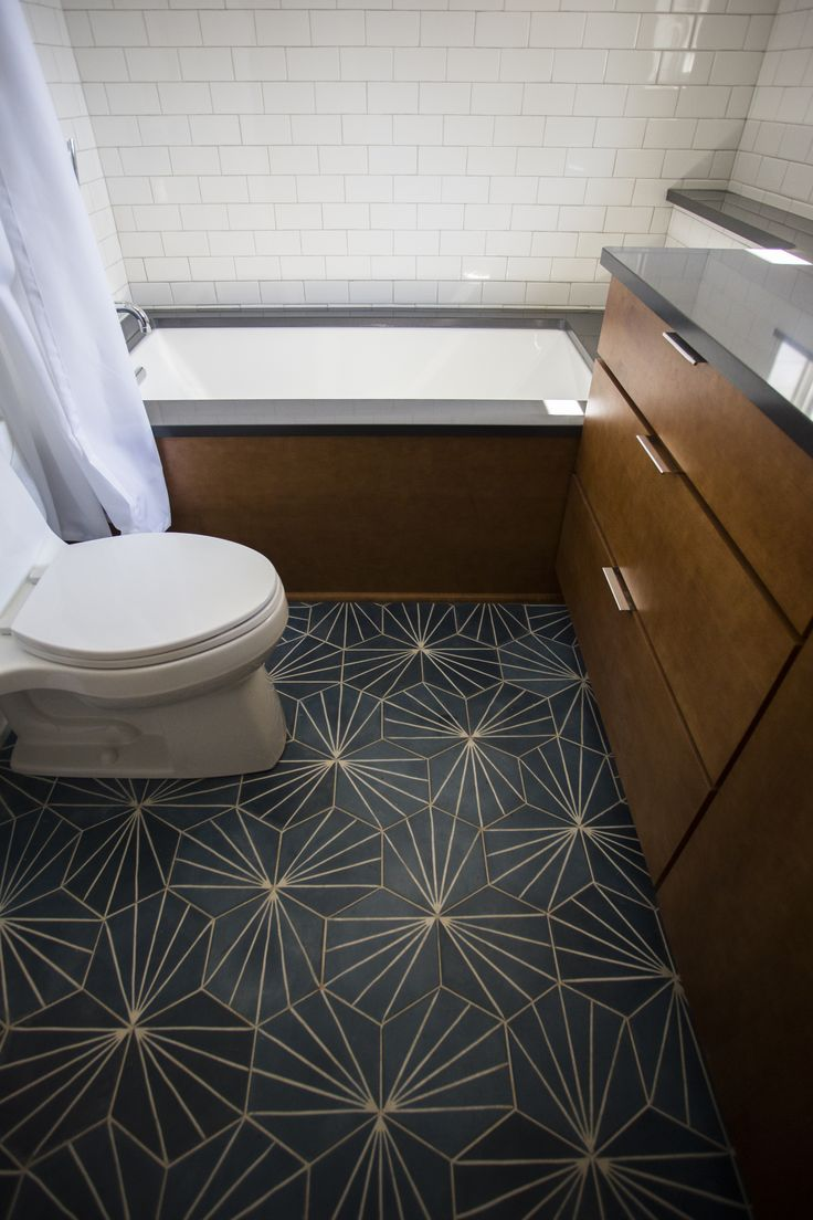 Beautiful Dandelion Concrete Floor From Marrakech Design In The Fully Renovated Hall Bathroom Of A Home