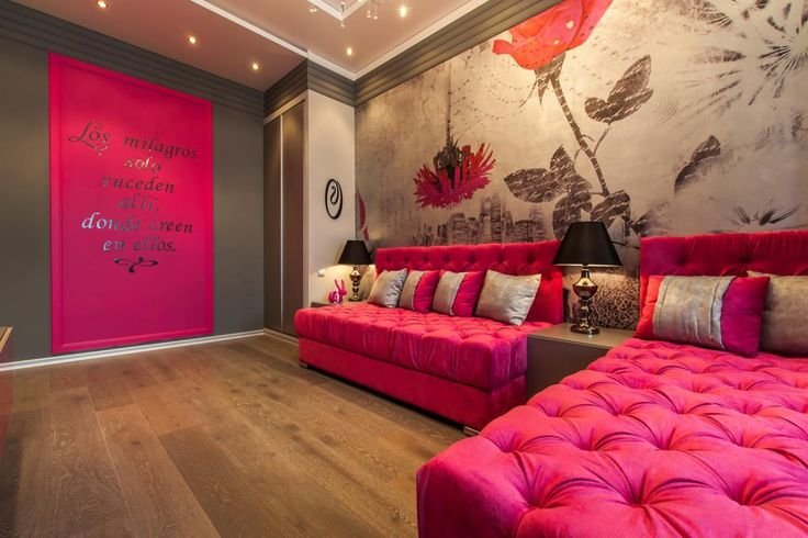 http://www.drissimm.com/wp-content/uploads/2015/11/beautiful-pink-living-room-design-with-floral-wallpaper-wall-behind-pink-cushions-between-table-plus-table-lamp-above-wooden-floor-and-under-lighting-ceiling-design.jpg