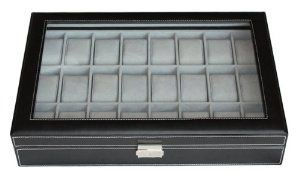 """Elegant 24 Piece Black Leatherette Watch Display Case and Storage Organizer Box by TIMELYBUYS. $59.99. Case measures 11.25"""" L x 17"""" W x 3"""" H; Each compartment measures 45 mm in width (3.25"""" L x 1.75"""" W). Secure your collection with our elegant lock and key. Detailed white stitching and attractive faux suede lining add a luxury feel. Tastefully protects, stores, and organizes up to 24 watches. Removable pillows make room for other accessories. Store up to 24 of you..."""