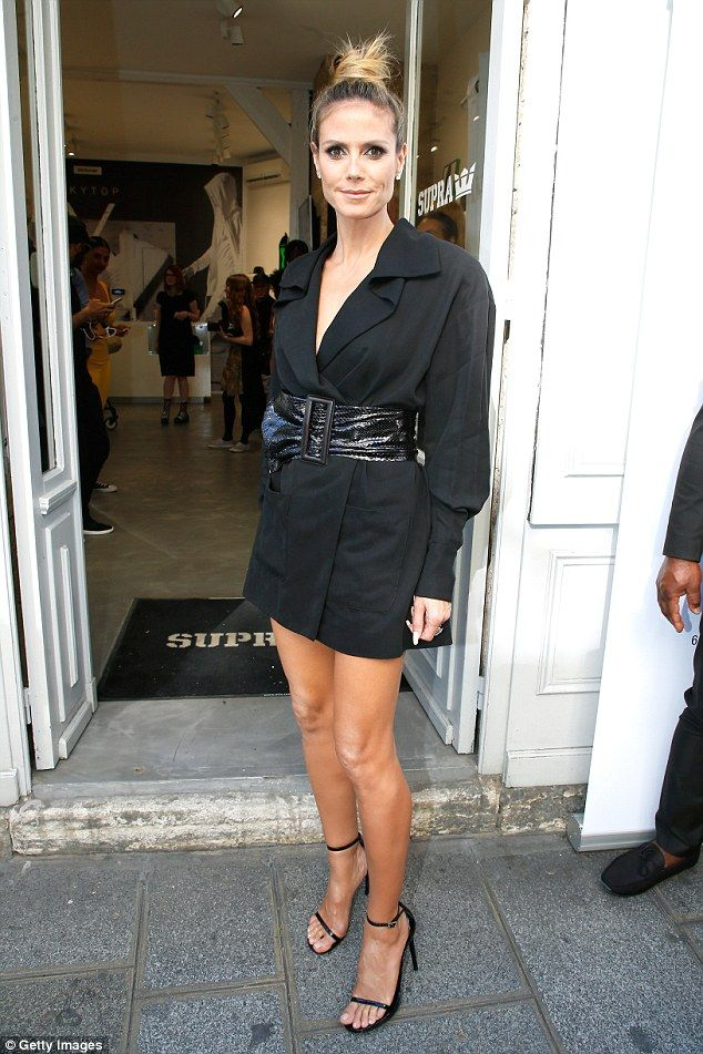 Heidi Klum, 43, shows off her incredible pins in nothing but a black jacket and belt as she attends the launch of Rankin's new photography book... in which she appears NAKED