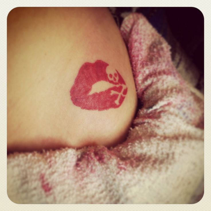 My red lip print tattoo with skull and crossbones!