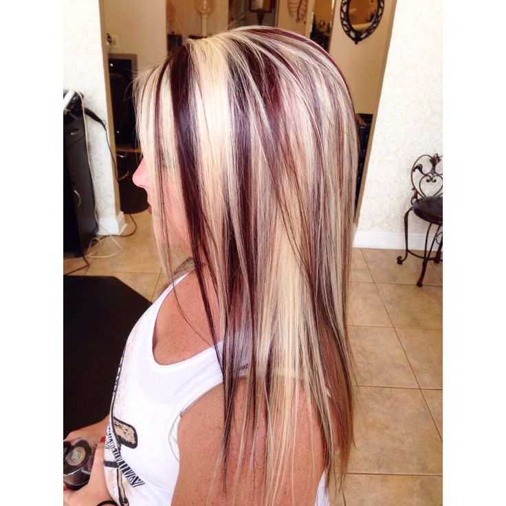 Highlights with red/violet lowlights by Brittany at stouts salon in Knoxville Tennessee blonde hair