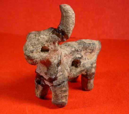 Prehistoric figurine of a bull, 5th-4th millenium B.C. Prehistoric figurine of a bull, Balkans area, 6 cm long. Private collection