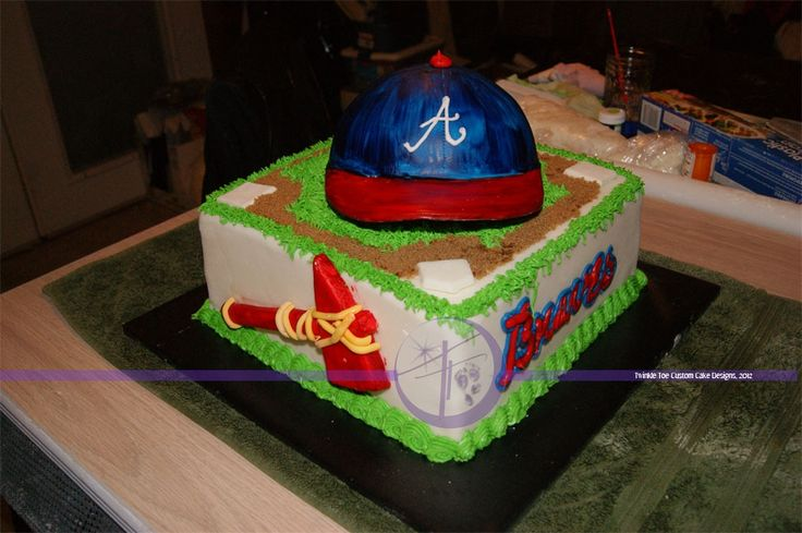 Atlanta Braves - Basic white cake with buttercream & MMF covered.  The entire cake is edible, with the exception of the hat bill, which is a piece of thin cardboard covered with MMF.  Made for a guy who is moving to Atlanta for his job.