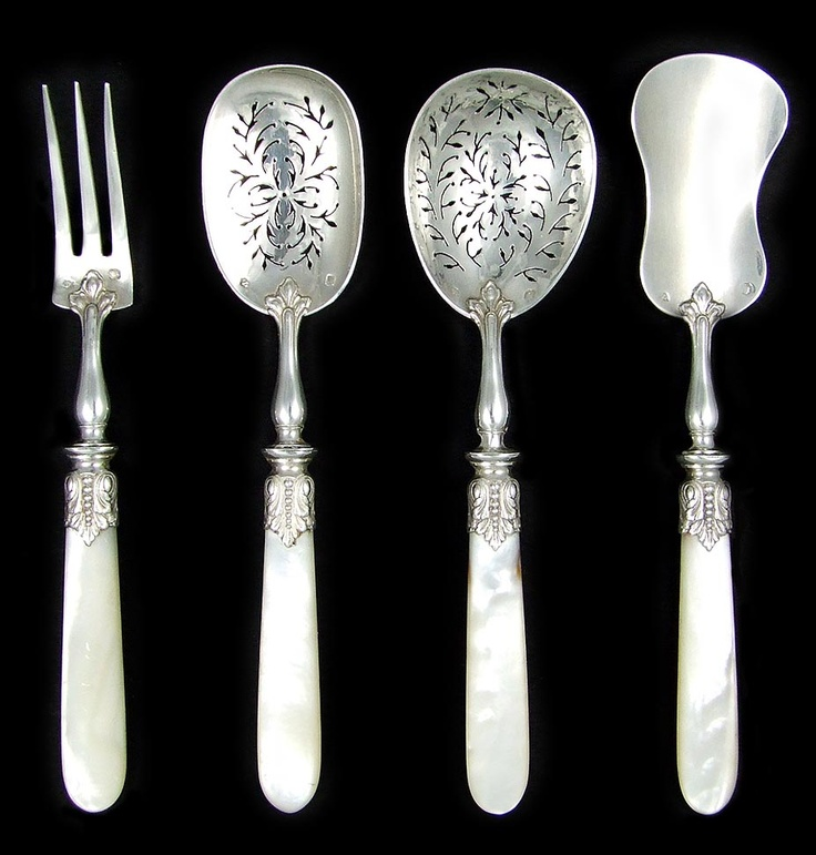 A superb 19th century French sterling silver set of four hors d'oeuvre serving pieces, all finely crafted and mounted with luminous mother of pearl handles. Comprising of a three pronged fork, two elegantly pierced serving spoons and a flat server. Housed in their original blue satin lined presentation box, the set is richly decorated with detailed ferrules in an acanthus motif. From The Antique Boutique. www.theantiqueboutique.rubylane.com
