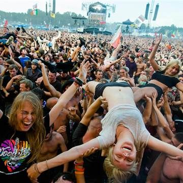 A woman crowd-surfs in front of the main stage at the Woodstock Festival in Kostrzyn-upon-Odra, close to the Polish-German border, on August 2, 2014.