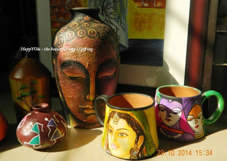Terracotta pots, mugs, flower vase. All hand painted with exclusive art forms .A unique gift for your loved ones.