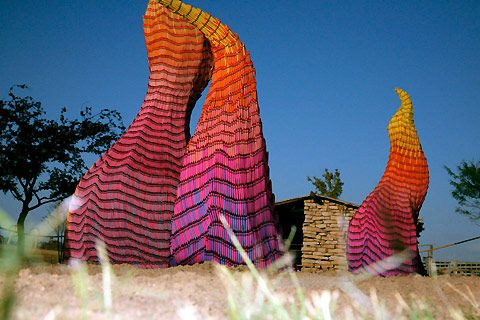 "Artist Herb Williams used thousands of large crayons to create a field of flames that will melt, move, and solidify as sun rays and wind hit them and temperatures rise and fall. The installation at the National Ranching Heritage Center in Lubbock, Texas, entitled ""Unwanted Visitor: Portrait of Wildfire,"" is intended to melt, move, and change considerably."