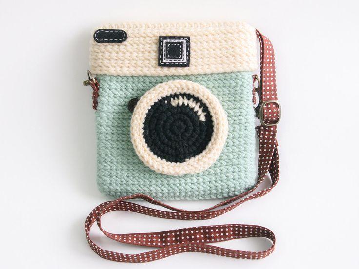 Una carterita con forma de cámara fotografica