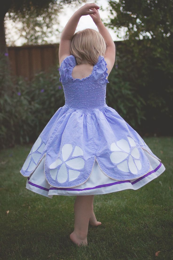 Welcome back to our costume tutorial series.   Today we have Sarah here to  share her gorgeous Princess Sofia dress created with the Tasha Dress by  Foo Foo Threads.  It is adorable, and I can imagine many princesses from  this pattern! (*Don't miss out on the pattern for the Sofia Emblem HERE.)