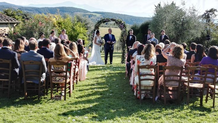 Garden wedding in Tuscany, Italy - romantic outdoor ceremony in front of beautiful scenery. by www.tuscantoursandweddings.com