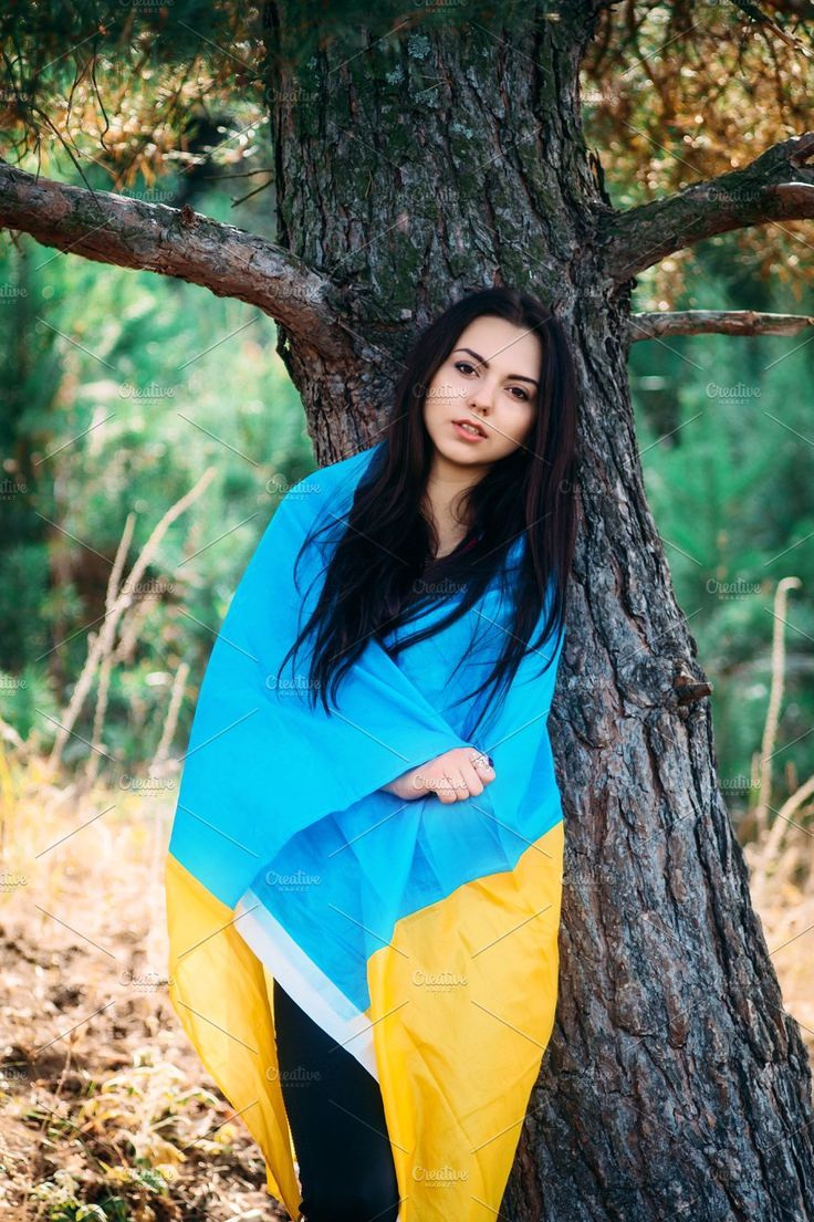 Beautiful brunette model posing in a park with  flag of Ukraine by Oleksandr Masnyi on @creativemarket