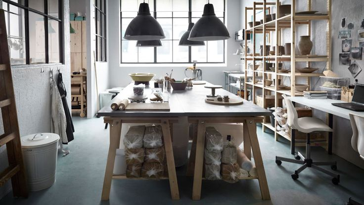 Pottery workshop with solid pine storage and worktable made of pine trestles with grey table top