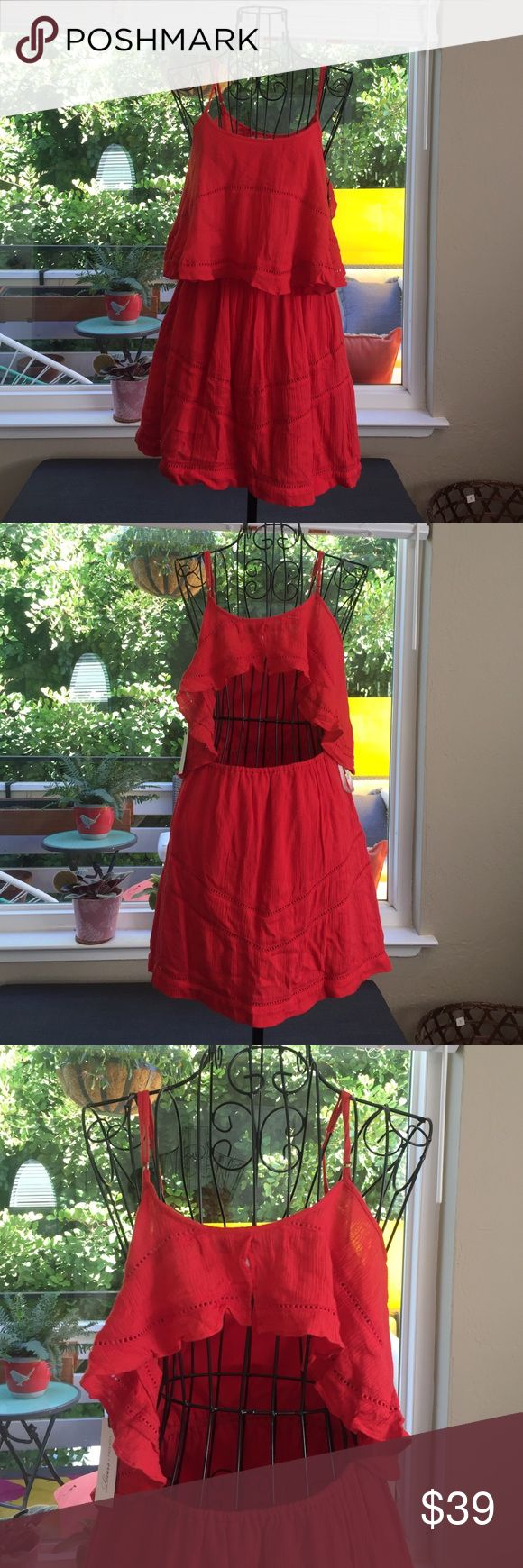Lovers + Friends Flirty coral colored dress NWT Super cute, nice details.  Open back, adjustable straps, fully lined skirt.  100% Rayon.  Color is a coral - not red, not orange but somewhere in between. Lovers + Friends Dresses Mini