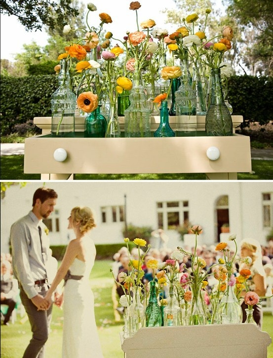 love the way these flowers look. Bud vases, lots of vessels with couple flowers in each, great colors