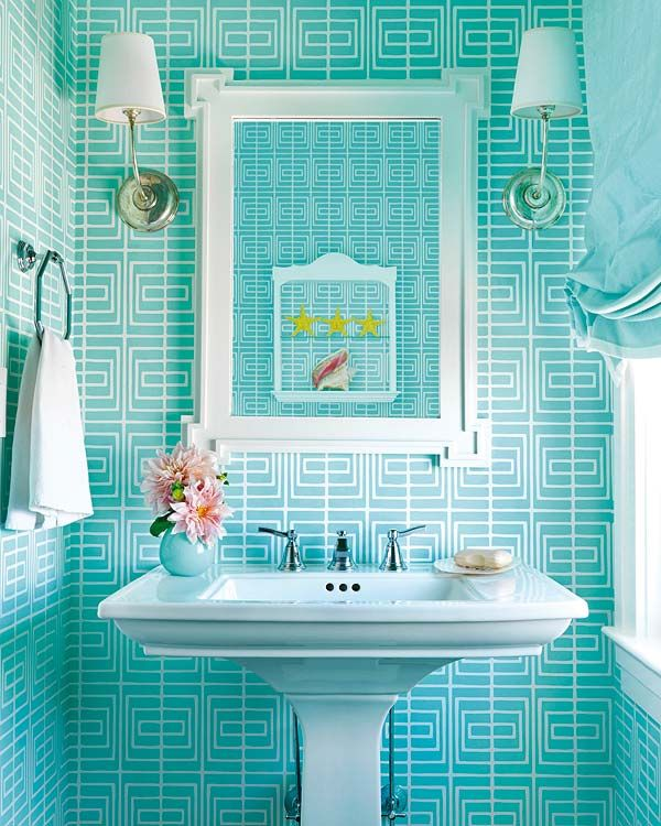 """a loud geometric in a bright ocean blue to give it a slightly over-the-top feeling."""" Wallpaper is from Studio Printworks."""