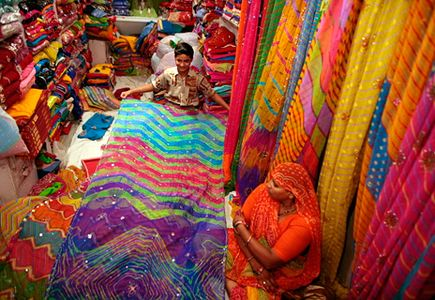 Photo: Udaipur sari shop    http://traveler.nationalgeographic.com/2007/10/genuine-article/morelli-text/1#