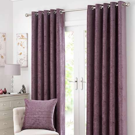 Crafted with a luxurious chenille texture and a subtle sheen, these readymade purple curtains are lined to minimise external light and noise entering, finished ...